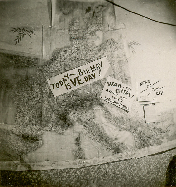 Note on back of photo:<br /> Save for my scrap book.  This is a picture of the Bn Progress Map on 8 May 45.