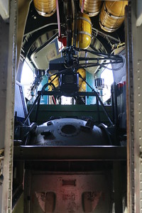 The ball turret of the B-24 sits below yellow canisters of oxygen. (Hunter Cresswell - The Times-Standard)