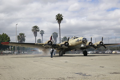 """The engine of the B-17 Flying Fortress """"Nine-O-Nine"""" kicks out a plume of smoke as it prepares to head to Humboldt County from Concord, CA on Monday morning. (Hunter Cresswell - The Times-Standard)"""