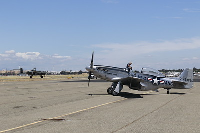 P-51 Mustang Betty Jane is worked on as the B-25 takes off. (Hunter Cresswell - The Times-Standard)