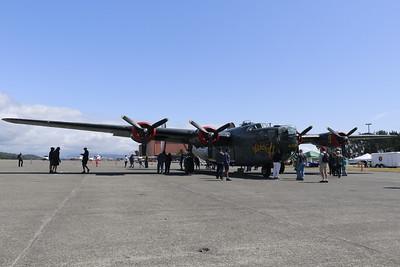 """Touchdown! Visitors gather around the B-25 Liberator """"Witchcraft"""" shortly after it landed in McKinleyville on Monday afternoon as part of the Collings Foundation Wings of Freedom Tour. (Hunter Cresswell - The Times-Standard)"""