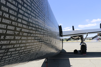 Names of past crew-members and sponsors adorn the right side of the B-24.  (Hunter Cresswell - The Times-Standard)
