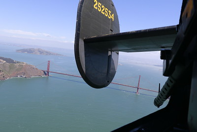 The B-24 flies over the Golden Gate Bridge on Monday afternoon. (Hunter Cresswell - The Times-Standard)