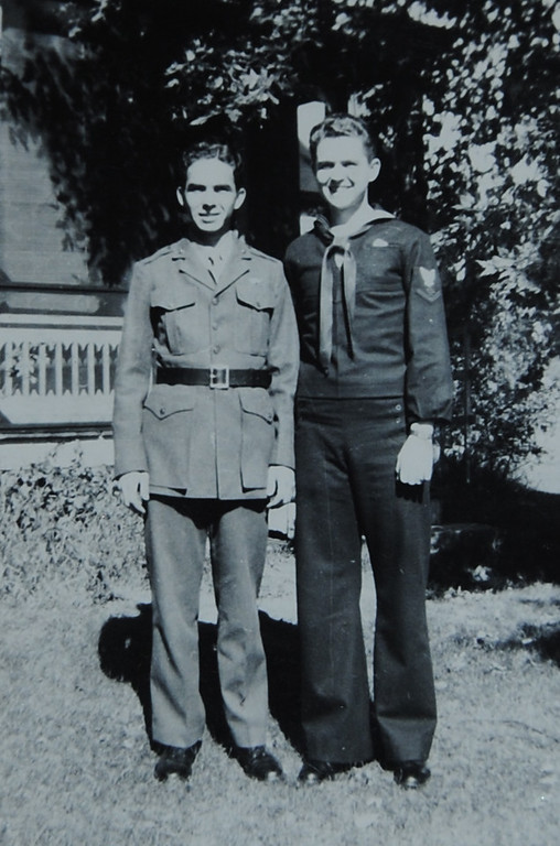 . COURTESY PHOTO/BETTY CLEARY Brothers Richard, right, and Joseph Cleary in front of the family home. Both joined the service during World War II. Richard was in the Marines, and part of the force occupying Japan. Joe was a Navy recruiter in New England.