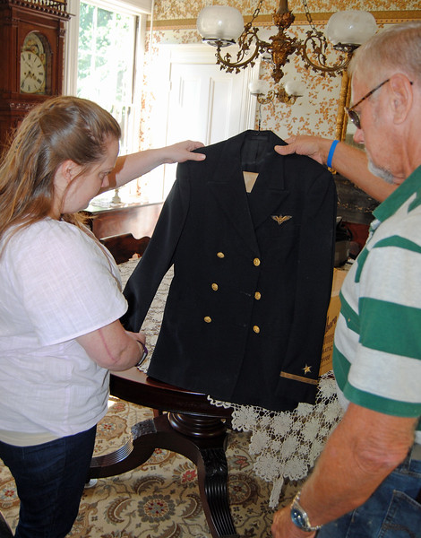 NASHOBA VALLEY VOICE/ANNE O'CONNOR<br /> The memory of Ensign Joseph E. Cutler has been preserved by his namesake and nephew Joe Cutler. He traveled up from Douglas to donate some of his collection to the Groton Historical Society. Shown with Kara Fossey, director of the society.