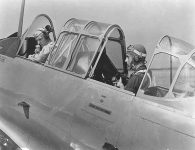 "A complete telephone system connecting A.C. instructor in the front cockpit and his Flying Cadet student pilot in the rear cockpit, a distance of 3 ft., is used at Randolph Field, Texas giant training field. Telephone dial is the only part that's missing…and of course, no ""busy signals""."