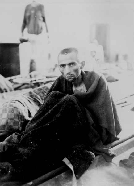 Starving inmate of Camp Gusen, Austria. May 12, 1945.