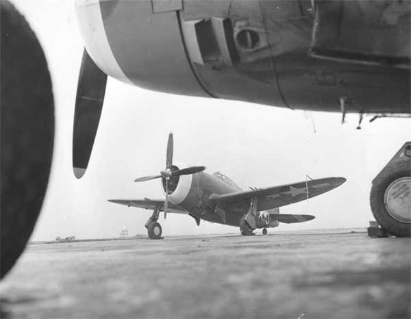 """England- A sturdy P-47 """"Thunderbolt"""", ready to go on a minute's notice. This plane, along with the P-38 """"Lightning"""", escorted Forts and Liberators to the Wilhelmshaven Naval Base, November 3, 1943."""