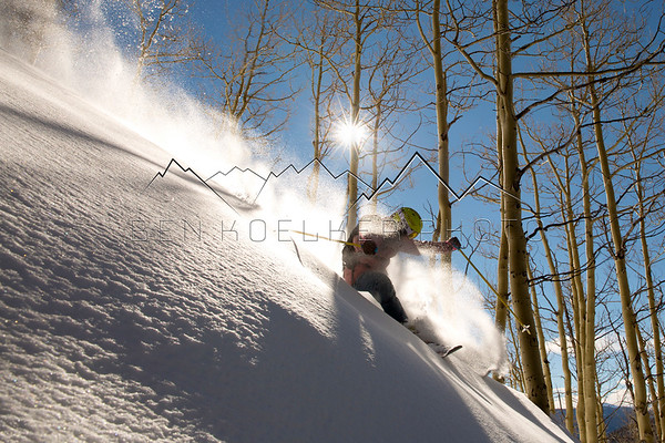 Rebecca Selig skiing on a bluebird Colorado day