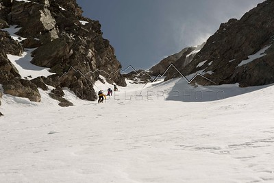 Mark Koelker, Wayne Bolte and Joe Otremba climbing up a couloir on Fool's Peak, CO