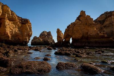 Stones and orange cliffs