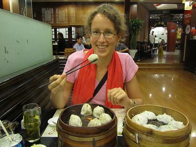 Eating tasty dumplings in Shanghai