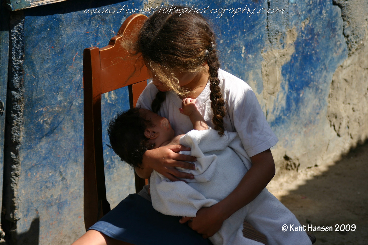 I captured this image while doing community development work with Food For The Hungry in the Dominican Republic. I had a team of College students  working in the mountain village of Las Flores building a home next door to where this girl sat caring for her brother. I was deeply touched by the tenderness of this moment.
