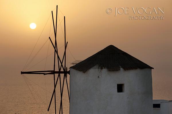 Windmill at sunset, Oia, Island of Santorini, Greece