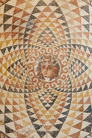 Mosaic Floor of Bacchus (Dionysos), Ancient Corinth Museum, Greece<br /> Decorated with the head of Dionysos.  From a roman villa, circa 2nd century A.D.