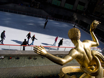 Statue of Prometheus watches over skaters