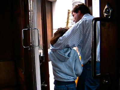 Riding the open door of the moving tram