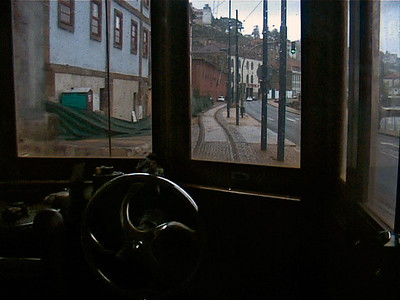 The street unwinds behind the tram