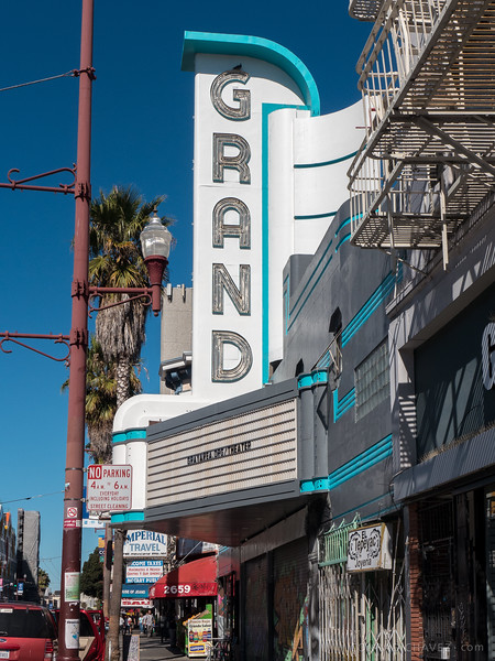 "2014: The freshened-up marquee of the Grand. The Gray Area arts organization (<a href=""http://grayarea.org/theater"">grayarea.org/theater</a>) signed a ten-year lease to operate the Grand as an ""art and technology theater."" In the background, the New Mission marquee is wrapped during restoration."