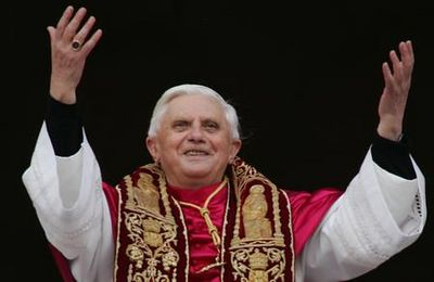 Newly elected Pope Joseph Ratzinger of Germany waves to the crowd from the central balcony of St. Peter's Basilica, at the Vatican, Tuesday, April 19, 2005. (AP Photo/ Andrew Medichini)