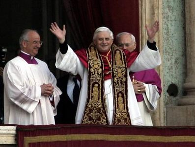 The newly elected Pope, Joseph Ratzinger of Germany, waves to the crowd from the central balcony of St. Peter's Basilica at the Vatican, Tuesday, April 19, 2005. Ratzinger is the  265th pontiff of the Roman Catholic Church. (AP Photo/Jasper Juinen)