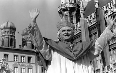 With the towers of Munich's cathedral inthe background, Joseph Cardinal Ratzinger raises his arms to bid farewell to Bavarian believers in downtown Munich in this  Feb. 28, 1982 file photo. A service in the cathedral and a walk through the crowd marked the farewell of the cardinal who will head the Congregation of Faith in the Vatican.  Cardinal Joseph Ratzinger of Germany, a longtime guardian of doctrinal orthodoxy, was elected the new pope Tuesday April 19, 2005 in the first conclave of the new millennium. He chose the name Pope Benedict XVI. (AP Photo/Dieter Endlicher)