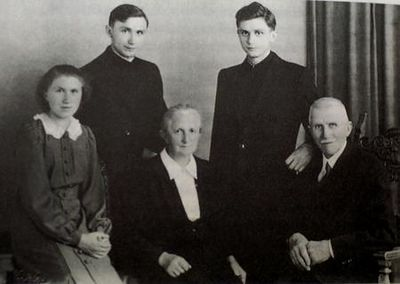 In this photo released by the German Catholic News Agency KNA and dated from July, 8, 1951  Joseph Ratzinger, standing right,  is seen with his family, father Josef, mother Maria and sister Maria, seated from right, and brother Georg following their ordination to the priesthood. Cardinal Joseph Ratzinger of Germany, a longtime guardian of doctrinal orthodoxy, was elected the new pope Tuesday April 19, 2005 in the first Roman Catholic conclave of the new millennium. He chose the name Pope Benedict XVI.(AP Photo/KNA)  ** GERMANY OUT AUSTRIA OUT SWITZERLAND OUT **