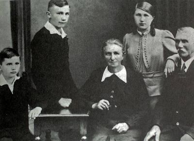 In this photo released by the German Catholic News Agency KNA and dated from 1938  Joseph Ratzinger, far left,  is seen with his family, father Josef, sister Maria, mother Maria, brother Georg. Cardinal Joseph Ratzinger of Germany, a longtime guardian of doctrinal orthodoxy, was elected the new pope Tuesday April 19, 2005 in the first Roman Catholic conclave of the new millennium. He chose the name Pope Benedict XVI. (AP Photo/KNA)  ** GERMANY OUT AUSTRIA OUT SWITZERLAND OUT **