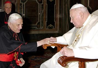 ** FILE ** Cardinal Joseph Ratzinger, then-Prefect of the Catholic Church's Congregation for the Doctrine of the Faith, kneels in front of Pope John Paul II during the traditional exchange of Christmas greetings at the Vatican in this Dec. 22, 2003 file photo.  Cardinal Joseph Ratzinger of Germany, a longtime guardian of doctrinal orthodoxy, was elected the new pope Tuesday April 19, 2005 in the first conclave of the new millennium. He chose the name Pope Benedict XVI. (AP Photo/Osservatore Romano/ File)