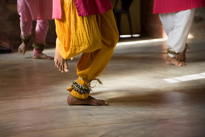 Ankle bells punctuate the performance when the dancers stomp their feet.