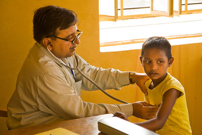The campus includes a health clinic where children receive regular checkups from Dr. Rajesh Gupta.