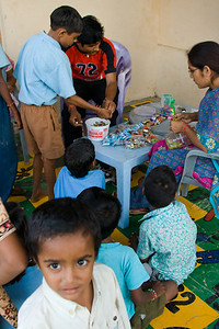 "Each week at the Sunday Shop, children bring credits they've earned during the week and ""buy"" goods. Vatsalya created this basic economic system to teach children how to earn, save, budget, and spend money."