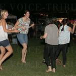These women enjoyed dancing shoeless on the grass.