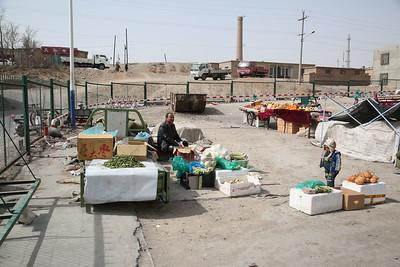 Sandaoling market - a farmer selling his wares - 21/03/17.