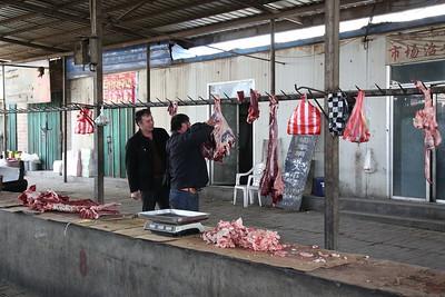 Sandaoling market - some sort of butchery occurring - 21/03/17.