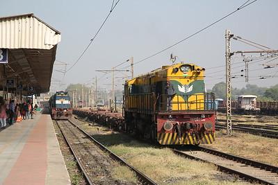 IR WDS6R 36507, Sabarmati Junction, shunting flat wagons .... WDM3D 11416 passes through on 19568 23.55 Okha-Tuticorin - 24/11/17.