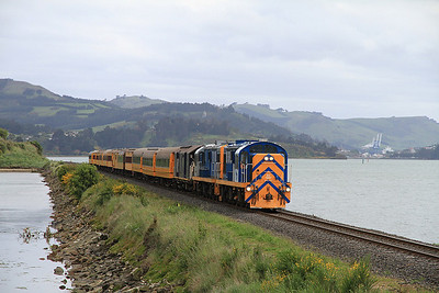 TGR DJ1227 + DJ3107 cross a causeway between Port Chalmers and Dunedin on J03 08.45 Port Chalmers-Pukerangi - the Cruise-Ship can just be seen in the distance on the right - 19/11/2011.