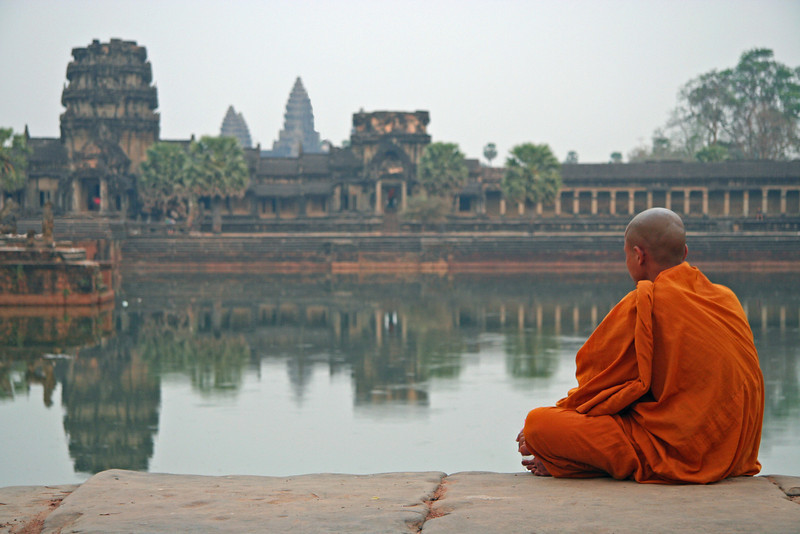 A Buddhist Monk meditating at Angor Wat, Cambodia