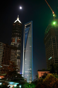 The Jin Mao Tower (left) and the Shanghai World Financial Center (right)