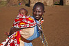 A Masai woman carrying her child