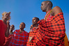 Masai men singing and dancing