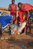 Masai obtaining blood from a cow which will be mixed with milk and drank as a source of protein