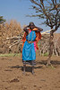 A Masai woman bringing a load of fire wood to her village