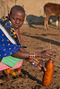 A Masai Woman stirring cow blood to prevent it from coagulating