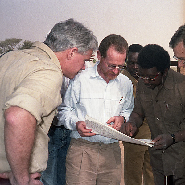 Richard Cuenca, Steve Prince and a Nigerien expert confer.