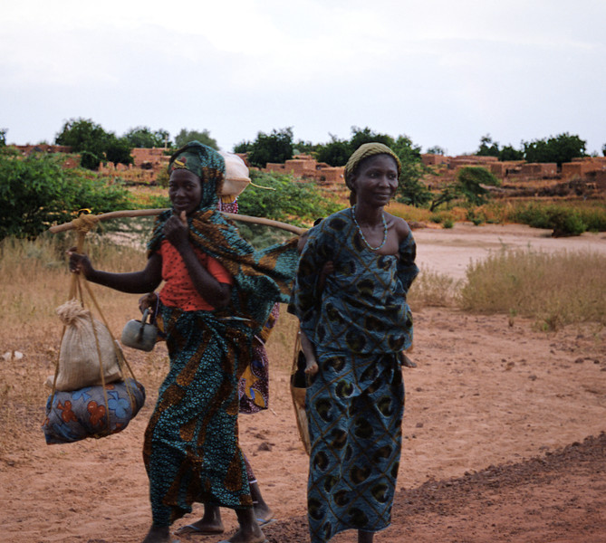 Two women outside their village.