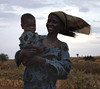 This young woman and her child were on their way to a neighboring village, or, perhaps a distant market.