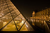 Looking into the Louvre pyramid at night.