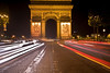 The Arc du Triomphe at night.