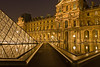 The Louvre courtyard at night.